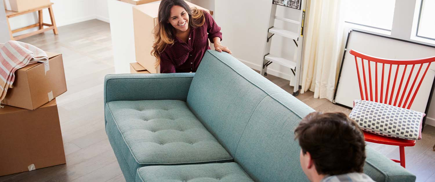 couple moving a couch for a short distance move