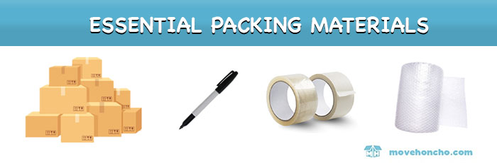 moving box packing materials including empty boxes, bubble wrap, permanent marker, and tape