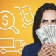 woman holding hundred dollar bills over her face, looking out of the corner of her eye at moving icons, wondering what the cheapest way to move cross country is